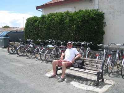 Dave sitting by a Euonymus Bravo hedge with a few bicycles